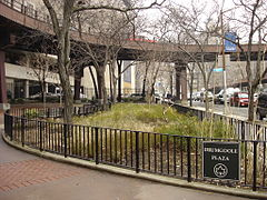 Drumgoole Plaza by Pace University and an overpass.