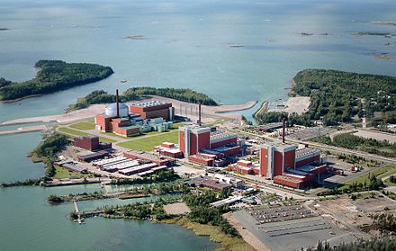 The two existing units of the Olkiluoto Nuclear Power Plant. On the far left is a visualization of a third unit, which, when completed, will become Finland's fifth commercial nuclear reactor. EPR OLK3 TVO fotomont 2 Vogelperspektive.jpg