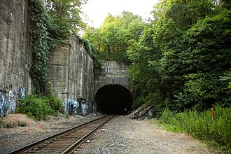 """Long Dock Tunnel - Eastern portal above which are three engraved stones. The first lists the officers and engineers of the company. The seconds reads """"Long Dock Company founded 1856"""". The third reads """"Bergen Tunnel completed 1861""""."""
