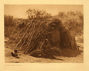 El Vallecito - Kumeyaay woman in front of her traditional house at Campo, photo by Edward Curtis.
