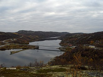 Norway–Russia border - Looking upstream from Elvenes; the bridge and community is in Norway while the river further up is in Russia