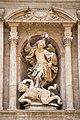 Estatua del arcángel San Miguel en la fachada principal de San Miguel de los Reyes.jpg