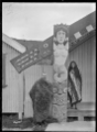 Exterior view of Wairaka Meeting House, Whakatane, showing the marakihau (mermaid) carving on the left amo ATLIB 291936.png