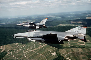 Seventeenth Expeditionary Air Force - A F-4G Phantom II Wild Weasel from 480th Tactical Fighter Squadron and a F-16C Block 25 Falcon from 52d Tactical Fighter Wing Commander fly over Germany in June 1989