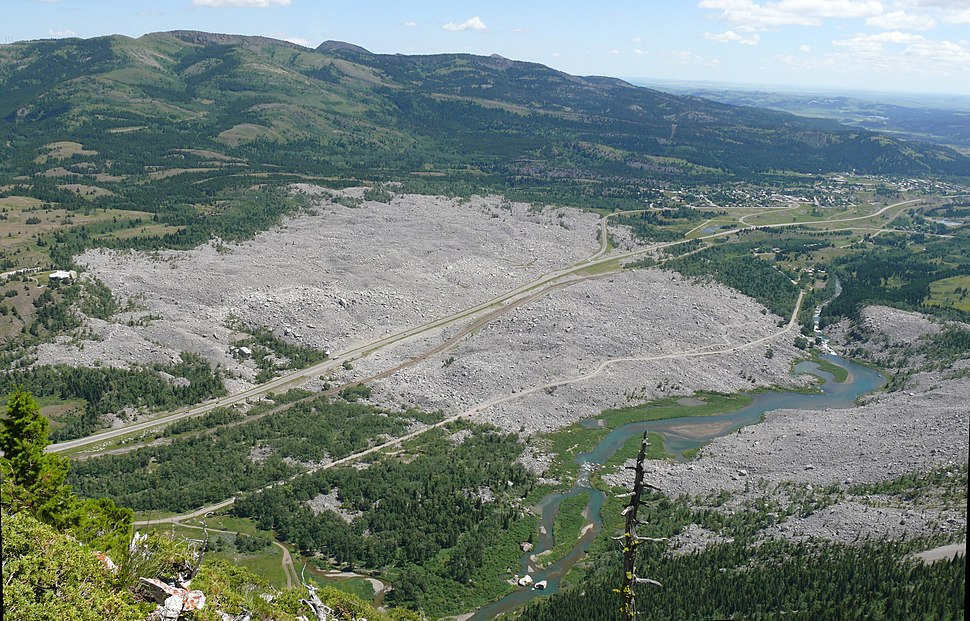 View from the north shoulder of Turtle Mountain. The Frank townsite was where the old road leaves the slide on the left. Frank Lake was created by the slide. Bellevue is at top right. The Interpretive Centre is at left.(2013)