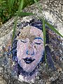 Face painted on a rock in Pollock Island Park in Winnipeg, Manitoba, Canada. (42565474651).jpg