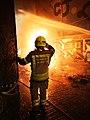 Falla on fire with fireman (bombero). Valencia. Fallas festivities.jpg