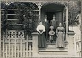 Family on the porch of a mill house at Port Blakely, 1909 (MOHAI 5478).jpg