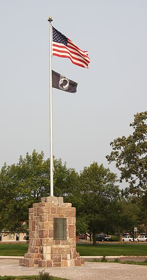 National League of Families POW/MIA Flag - POW/MIA flag flying below the US flag.