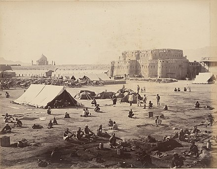 British and allied forces at Kandahar after the 1880 Battle of Kandahar, during the Second Anglo-Afghan War. The large defensive wall around the city was removed in the early 1930s by order of King Nadir. Kandahar-1881.jpg