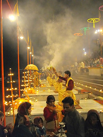 2010 Varanasi bombing - Evening Ganga Aarti at the adjacent Dashashwamedh Ghat, Varanasi in 2008, with people watching from the steps above.