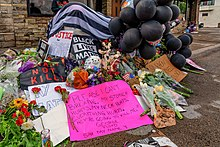 Tribute items left at site of death forming a makeshift memorial