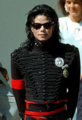 George H. W. Bush with Michael Jackson (cropped).png