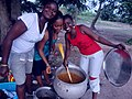 Ghanaian women cooking jollof.jpg