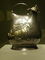 Gilt silver jar with pattern of dancing horses.jpg