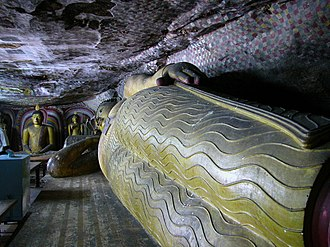 Sri Lanka - Sculpture of reclining Buddha at Dambulla cave temple, declared World Heritage Site by UNESCO in 1991.