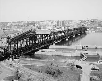 Government Bridge - 3/4 overall view from the Clock Tower Building (Building 205); looking NNW toward Davenport, Iowa. (Ceronie)
