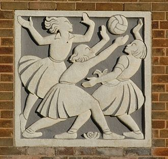 Netball in England - Relief carving at Great Barr School, Birmingham, England, showing girls playing netball.
