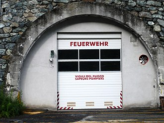 Gressoney-La-Trinité - Garage door of the local fire service in La-Trinité. The door is labelled in the three official languages: German, Italian and French.