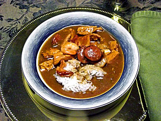 Gumbo Louisianan stew of a strongly-flavored stock, meat or shellfish, a thickener (okra, filé powder, or roux), celery, bell peppers, and onions