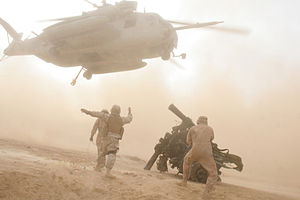 HMH-465 - A CH-53E from HMH-465 picking up a load of rotor blades from a downed chopper on December 25, 2006.