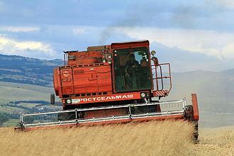 Economy of Bulgaria - Combine harvester near Slivnitsa. About 43% of Bulgaria's land is arable.