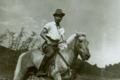 He Fei-guang riding horse.png