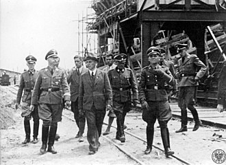Heinrich Himmler (second left) visits the IG Farben plant in Auschwitz III, July 1942. Heinrich Himmler, IG Farben Auschwitz plant, July 1942.jpeg
