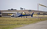 Heli-Aust Aérospatiale Industries AS350BA and Kennedy Air AT802 (background) at Wagga Wagga Airport.jpg