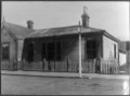 House after a fire, showing damage to walls, windows and roof, at Petone. ATLIB 338893.png