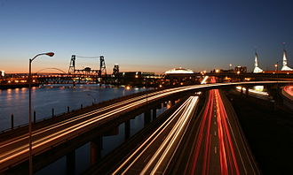 Interstate 5 - I-5 running adjacent to the Willamette River and passes by the Moda Center, and Oregon Convention Center in Downtown Portland