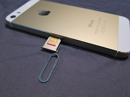 An iPhone 5S with the SIM slot open. The SIM ejector tool is still placed in the eject hole. IPhone sim slot.jpg
