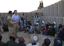 King (centre) speaking in Afghanistan, 2009
