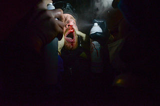 Injured protester receiving first medical aid in field. Kyiv, Ukraine. Jan 22, 2014.jpg