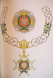 The insignia of a Knight Grand Cross of the military division of the order.