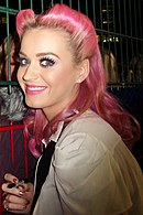 Katy Perry smiling towards the camera.