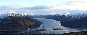 Loch Duich - Loch Duich from the north-west, with Eilean Donan Castle (middle foreground), Loch Long (left foreground), Loch Alsh (right foreground), and the mountains of Glen Shiel (centre background)