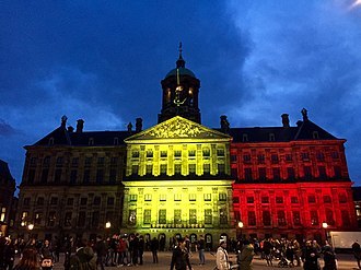 Reactions to the 2016 Brussels bombings - Royal Palace of Amsterdam lit in the colours of Belgian flag