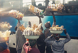 Kwekwe - Part of the informal sector in the town: vendors selling snacks to travellers in a bus.