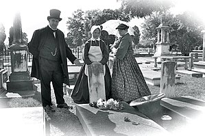 Linwood Cemetery (Columbus, Georgia) - Historical reenactors decorating the grave of Lizzie Rutherford, on which is inscribed her role as the mother of Memorial Day.