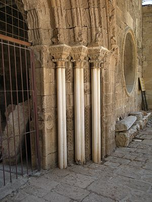 Lala Mustafa Pasha Mosque - St. Nicholas Cathedral, Famagusta, Cyprus, Loggia Bembo, detail of the entrance, circa 1480s. The heraldic devices of the Bembo family are on the abaci of the pillars and visible on the end of the marble seat.