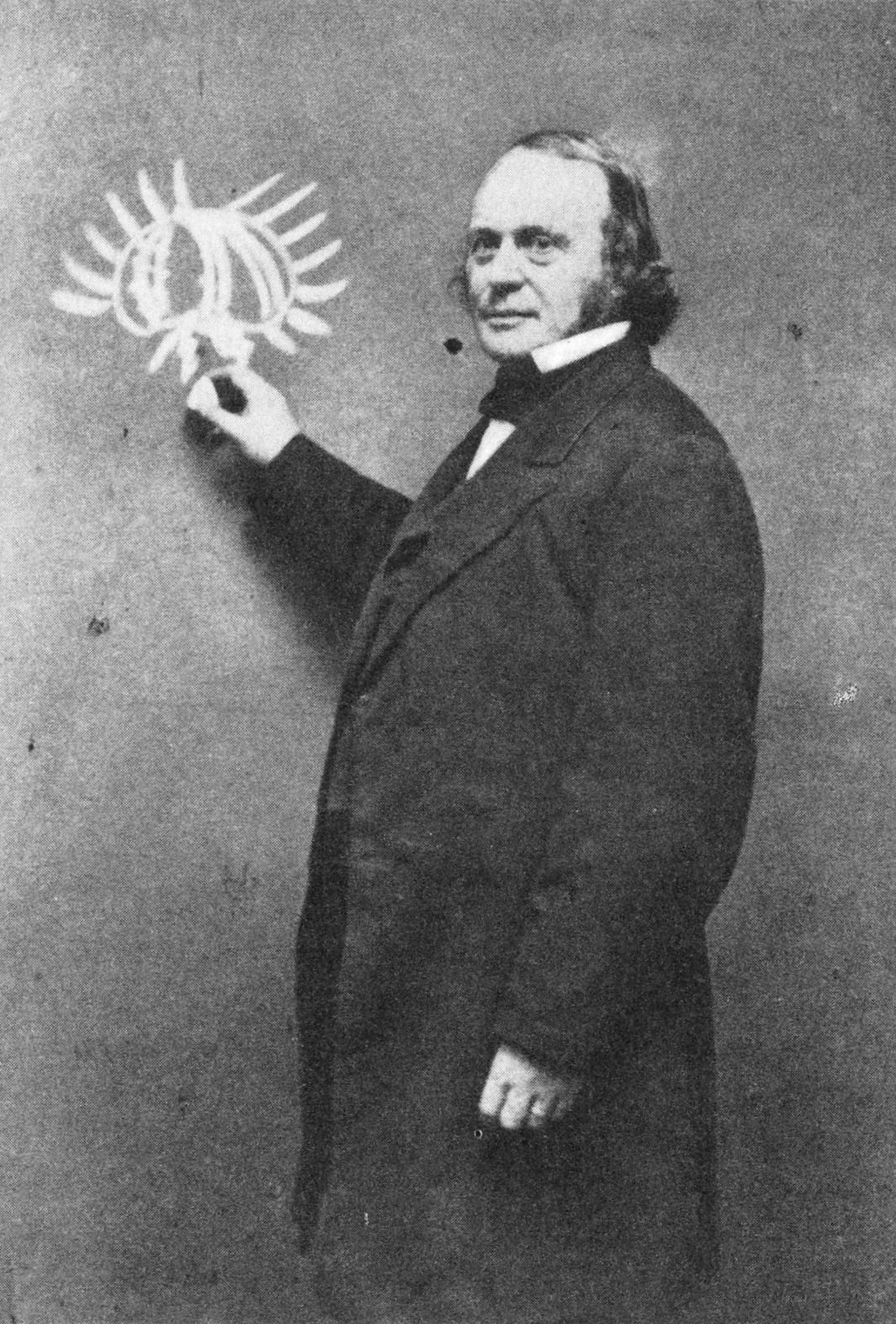 Louis Agassiz at a chalkboard