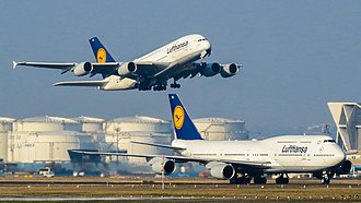 A Boeing 747-8I and Airbus A380-800 of Lufthansa at Frankfurt Airport. The A380 and 747-8, together with the recently introduced Airbus A350 XWB, form the backbone for Lufthansa's long-haul routes. Lufthansa Airbus A380 and Boeing 747 (16431502906).jpg