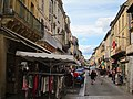 Main shopping street Sarlat at Wednesday. Every saturday is here a weekmarket - panoramio.jpg