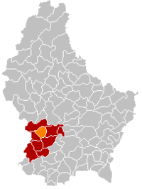 Map of Luxembourg with Koerich highlighted in orange, the district in dark grey, and the canton in dark red