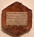 Mattonella esagonale della camera natale 'di sua maestà l'imperatone' napoleone, certificata nel 1882.jpg
