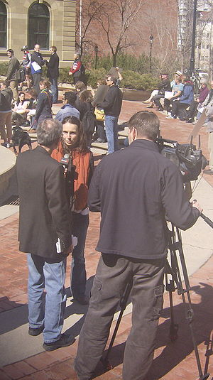 CICT-DT - Meghan Beveridge with the Bow Riverkeeper organization is interviewed by Global Calgary reporter Louis Koutis at a rally on April 13, 2007 in Downtown Calgary.