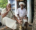 Men smoking hookah, near Jaipur, Rajasthan, India.jpg