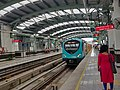 Metro train at kochi metro mg road station Ernakulam, Kerala, India.jpg