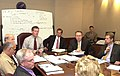 Mike Leavitt discusses Hurricane Katrina relief efforts with top Department officials.jpg